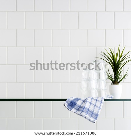 kitchen wall with glass shelf - stock photo
