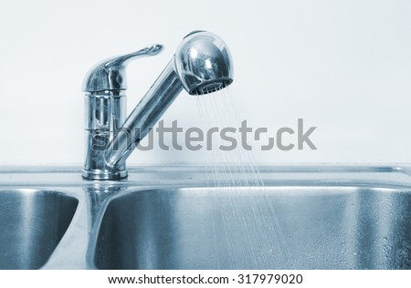 Kitchen Water tap and sink. Renovation  and plumbing. - stock photo