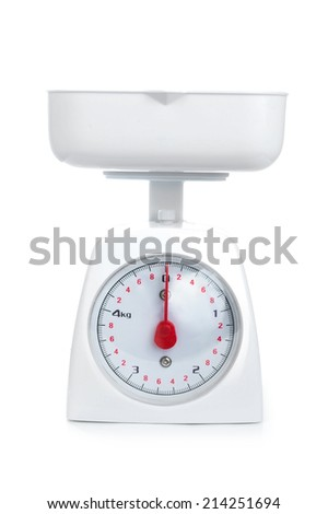 Kitchen weighing scale for food ingredients isolated on a white background - stock photo