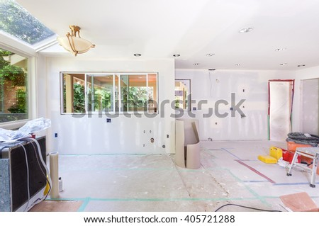 Kitchen windows installed, drywall taped and mud applied to seams - stock photo
