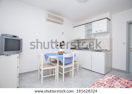 kitchen with a dining table - stock photo