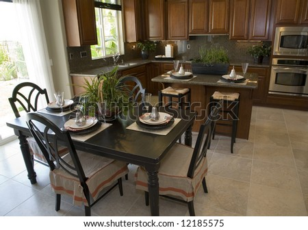 Kitchen with a tile floor and breakfast table.