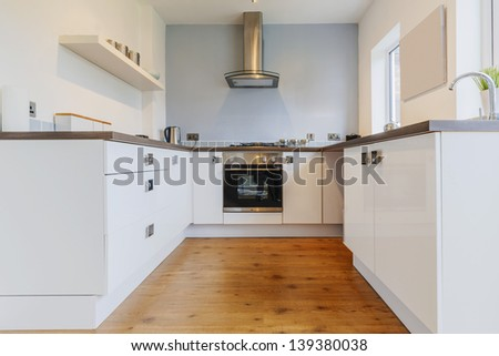 kitchen with appliances and table tops - stock photo
