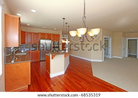 Kitchen with cherry cabinets and grey granite - stock photo