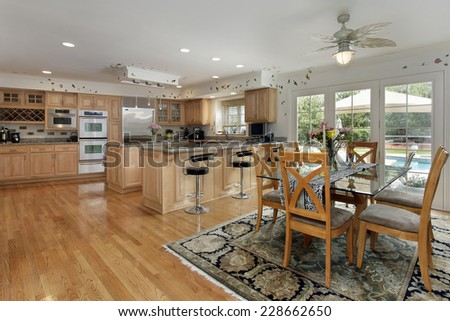 Kitchen with eating area and view of swimming pool - stock photo