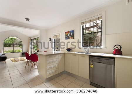 kitchen with modern twist along with hardwood floor,