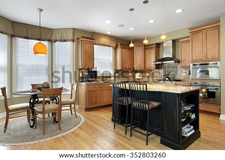 Kitchen with oak wood cabinetry and center island - stock photo