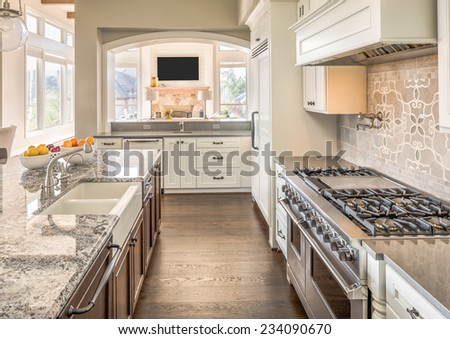 Kitchen with Range, Sink, and Hardwood Floors - stock photo