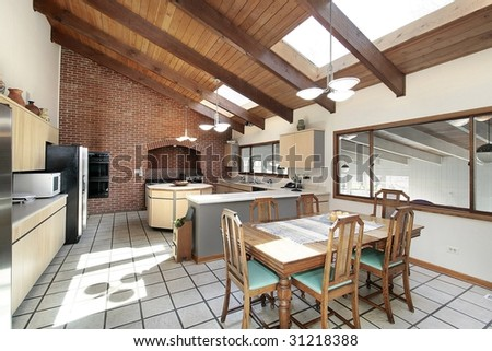 Kitchen With Skylights And Wood Beams