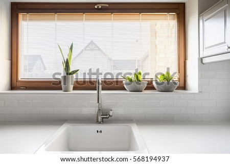 Sink stock images royalty free images vectors shutterstock - Lavish white and grey kitchen for hygienic and bright view ...
