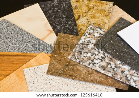 Kitchen worktop samples showing a variety of textured finishes available - stock photo