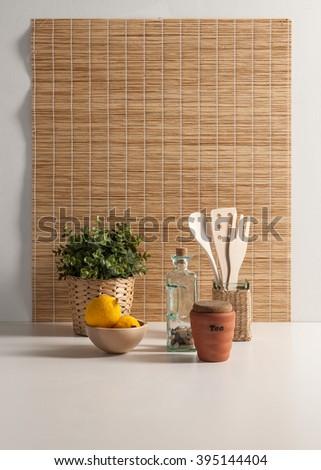 kitchenware behind wicker curtain - stock photo