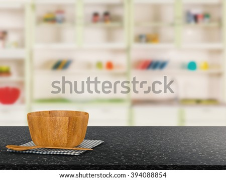 kitchenware on granite counter with kitchen blurred background - stock photo