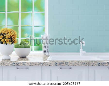 Kitchenware on the marble worktop in front of big light window. White kitchen design.