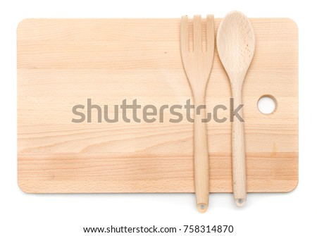 kitchenware utensil wooden spoon and fork laying on chopping wood