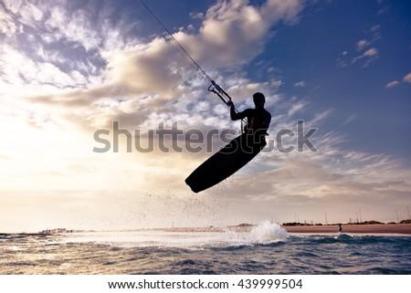 Kite Boarding. Kitesurf Freestyle at Sunset. - stock photo