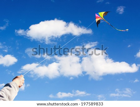 kite flying in a beautiful sky clouds. Focus on the kite