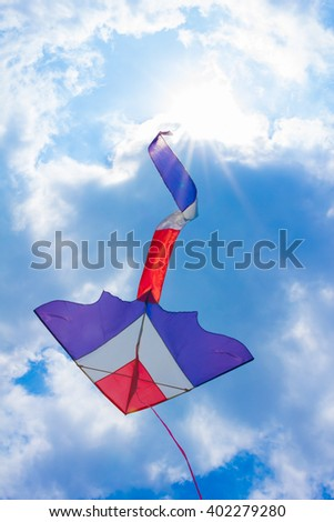 Kite flying in blue sky with toned and selective or blurred focus