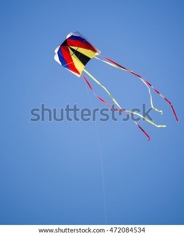 kite flying on blue sky