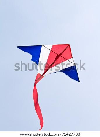 Kite flying on blue sky. - stock photo