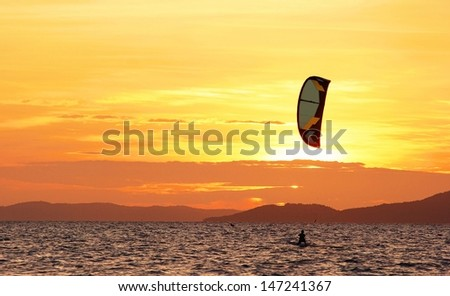 Kite skiing with the sunset