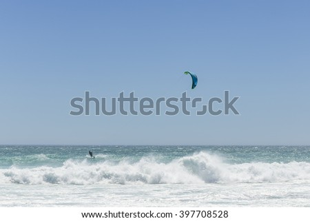 Kite surf, riding the waves. - stock photo