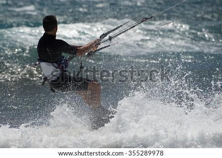 Kite surfer rides - stock photo
