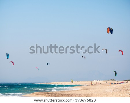kite surfers sailing in big waves in the island of Leukada in Greece