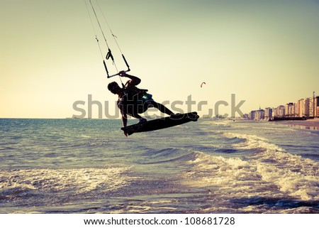 Kite surfing near the city of Cadiz, southern Spain. Vintage - stock photo