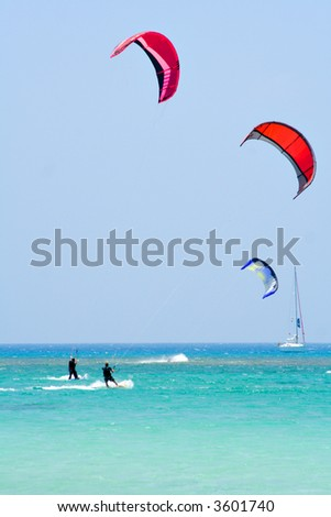 kite-surfing near the cost of Fuerteventura, sailboat in background