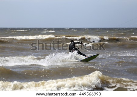 kiteboarder at the Dutch North Sea coast - stock photo