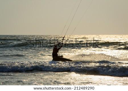 Kiteboarder enjoy surfing in the sea - stock photo