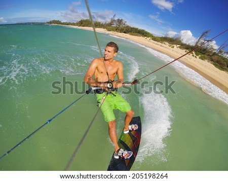 Kiteboarding, Fun in the Ocean, Extreme Sport.  - stock photo