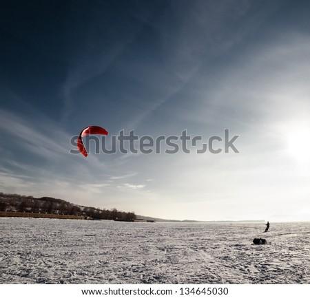 Kiteboarding or snow kite - stock photo