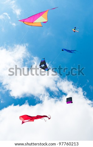 Kites Flying - against clouds and sky