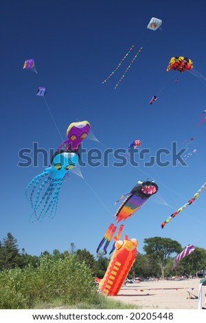 kites flying in a blue sky - stock photo