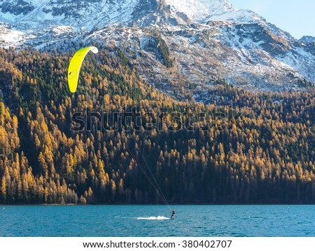 kitesurfer and view of the alp mountains in autumn