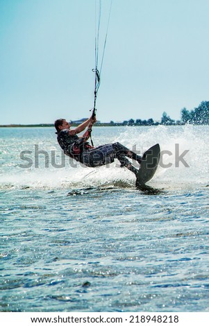 Kitesurfer surfing in Black Sea - stock photo