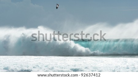 kitesurfing and surfing on huge waves of the Indian Ocean island of Mauritius - stock photo
