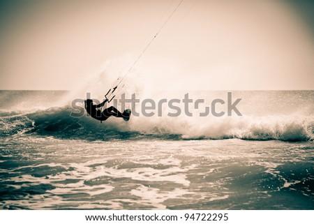 Kitesurfing in Andalusia, Spain. Retro look. - stock photo