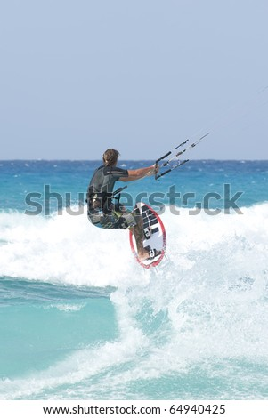 kitesurfing on the waves of the Mediterranean in Egypt - stock photo