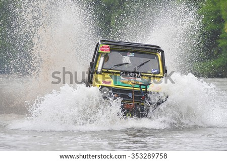 Kiulu Sabah Malaysia - Dec 20, 2015 :4x4 enthusiast wading a river using modified four wheel drive car in the rural of Sabah Borneo.Rural of Borneo is famous for 4x4 adventure tourism. - stock photo