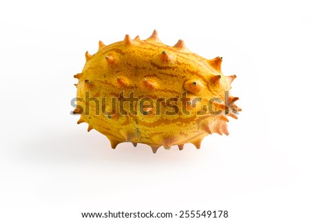 Kiwano (African horned melon, hedged gourd, African horned cucumber, English tomato) over white background - stock photo