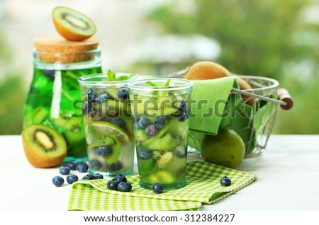 Kiwi and Blueberry cocktails on bright background