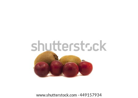Kiwi and plums on white background.