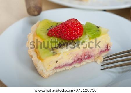kiwi and strawberry pie tart with lemon custard cream and spices - stock photo
