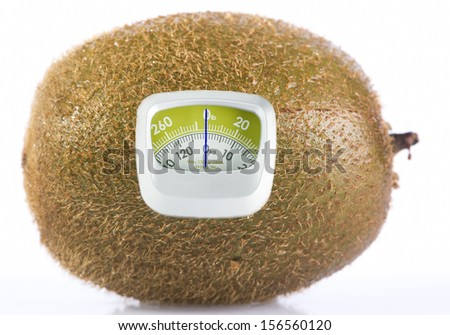 Kiwi Fruit and weight measurement meter-diet concept - stock photo