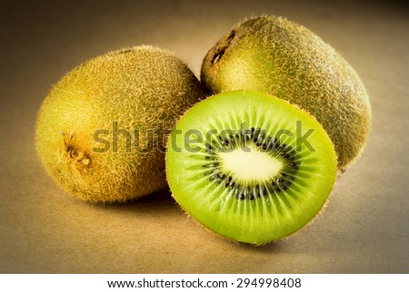 Kiwi fruit on a brown paper background. - stock photo