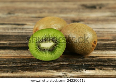 Kiwi fruit on brown wooden background - stock photo