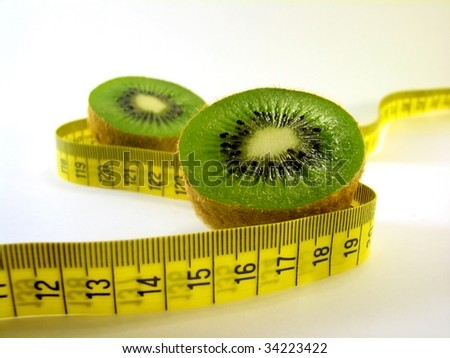 Kiwi fruit with tape measure - stock photo